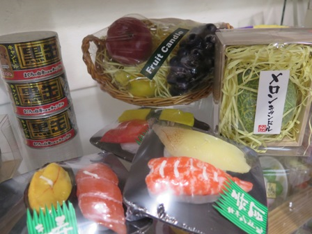 Candles in a shape of fruits, sushi and...